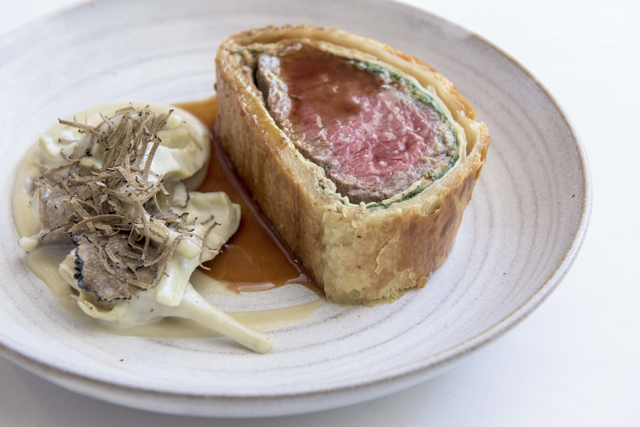 Luxurious Beef Wellington with Warm Baby Artichokes and a Truffle Vinaigrette